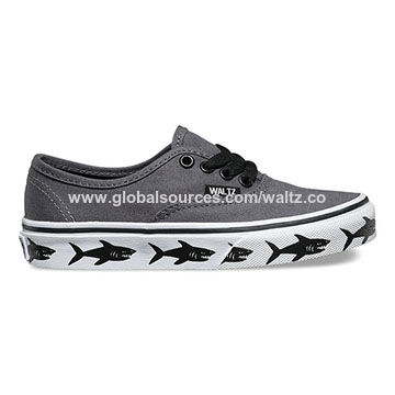 Bestselling children canvas shoes, with shark printing around the side of sole